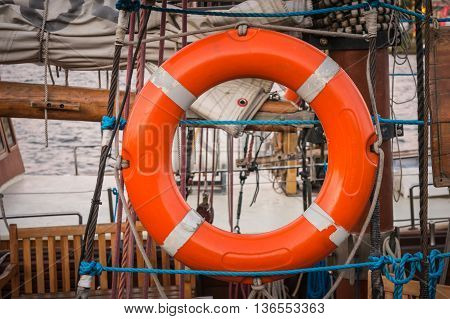 Orange Lifebuoy Carried By The Old Ship