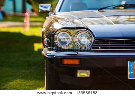 MINSK BELARUS - MAY 07 2016: Close-up photo of black Jaguar XJS 1984 model year. Close-up of the front part of an old black classic retro car. Selective focus.