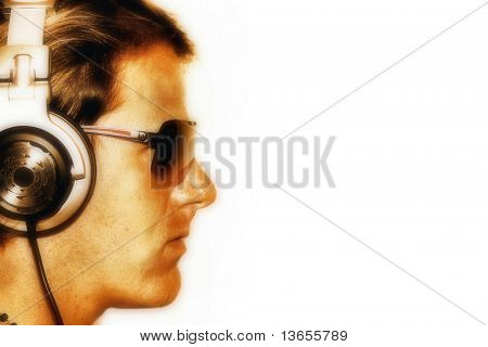Side profile of a cool DJ wearing sunglasses and headphones.