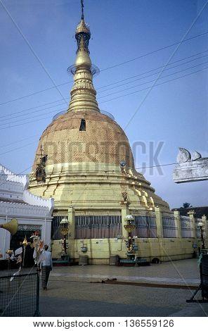 RANGOON / MYANMAR - CIRCA 1987: The golden Botataung Pagoda is a Buddhist place of worship in downtown Rangoon.
