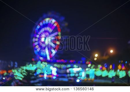 Blur image of modern light at the theme park with bokeh effect. Noise visible due to high iso