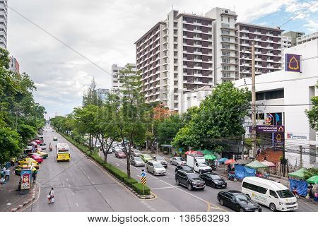 Bangkok Thailand - June 10 2016: Traffic moves slowly along a busy road front of Chulalongkorn hospital in Bangkok Thailand.