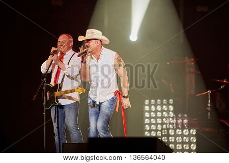 MOSCOW, RUSSIA - APR 24, 2015: Musicians of Secret band M.Leonidov and N.Fomenko in concert during show on stage of Crocus city hall. Rock and roll band Secret founded in 1982 in Leningrad.