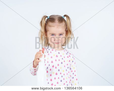Little Girl Holding A Watering Spray Bottle