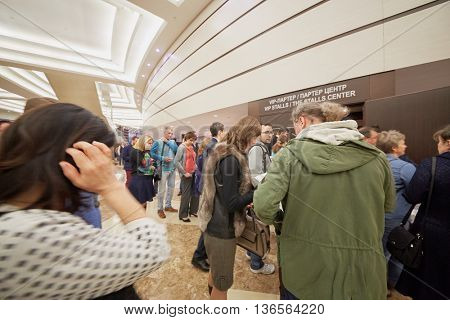 MOSCOW, RUSSIA - APR 24, 2015: People going to concert hall through VIP-stalls entrance in Crocus city hall on band Secret show. Rock and roll band Secret founded in 1982 in Leningrad.