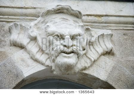 Architectural sculpture - mascaron - on the facade of a 18th century building in Nantes France. poster