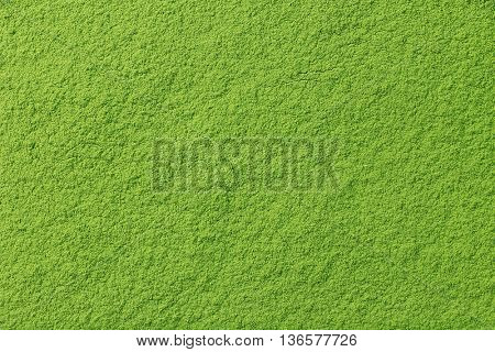 Powdered matcha green tea background, closeup