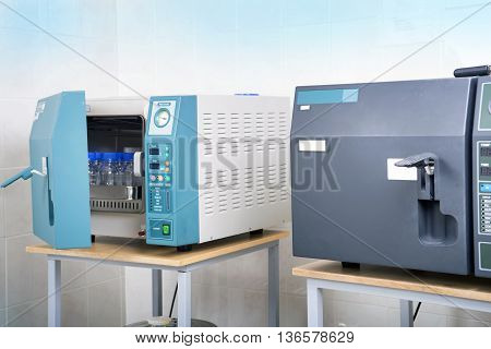 Modern laboratory autoclave sterilizer on the table