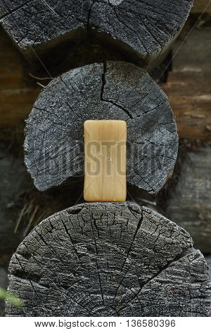 common soap household soap on old blockhouse wood close up
