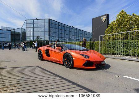 Sant'Agata Bolognese, Italy - April 30, 2016: Lamborghini parade in front of the Lamborghini factory in Sant'Agata Bolognese for the 100th Ferruccio Lamborghini Anniversary