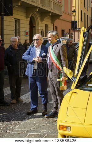 Sant'Agata Bolognese, Italy - April 30, 2016: Tonino Lamborghini together with the Mayor of Sant'Agata Bolognese , Giuseppe Vicinelli , during the parade for the 100th anniversary Ferruccio Lamborghini