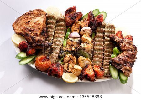 Plate of roasted meat in the restaurant