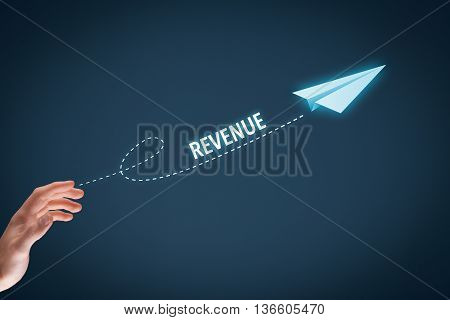 Increase revenue concept. Businessman throw a paper plane symbolizing growing revenue. Wide banner composition with bokeh in background.