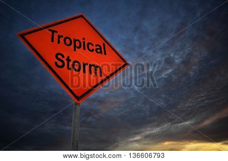 Tropical Storm warning road sign with storm background