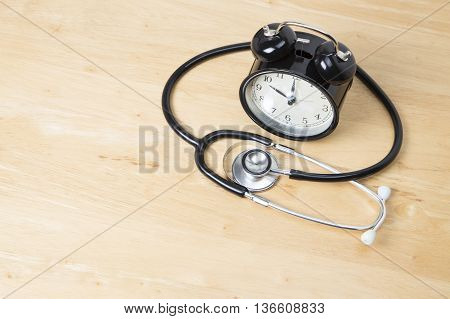 Hospital Waiting Times - Concept Clock With Stethoscope
