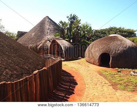 Traditional Zulu straw huts rondavels. Tribal ethnic style. Village in KwaZulu-Natal South Africa. Artistic retouching.