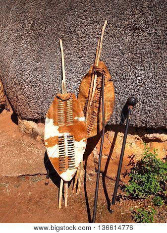 Close-up South African Zulu spears warrior shields and assegai. Traditional tribal ethnic weapon.