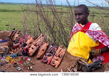Woman Sells Traditional Souvenirs At Maasai Mara, Kenya.