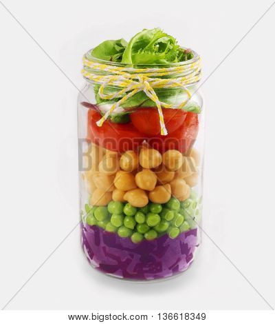 Salad in a jar. Healthy Homemade Mason Jar Salad. The concept of healthy proper nutrition for the whole family.