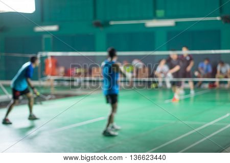 Four people are playing badminton - blur moving