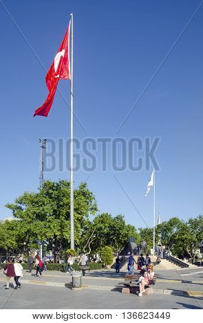 Istanbul, Turkey - May 29, 2016: Kadikoy Pier Square and 'headmaster Ataturk Monument' , the Turkish flag. Piers known Kadıköy Pier Square, one of the lifeblood of urban transport in Istanbul.   Besiktas Eminonu docks on one side, the other side of the sq