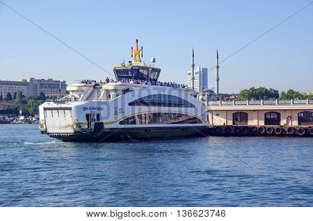 Istanbul, Turkey - May 29, 2016:  The new ferry for Istanbul, Kadikoy Pier.Ferries are the most popular form of public transport in Istanbul for one simple reason - if you're a local, you're always in a hurry except when you're on a ferry travelling from