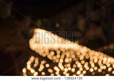 Blur Image Of People Light Candle To Pay Respect To Buddha Relic