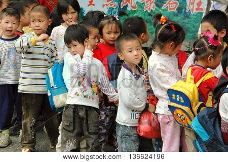 Guilin, China - April 28 2006: Chinese school children on a class outing to Seven Stars Hill Park