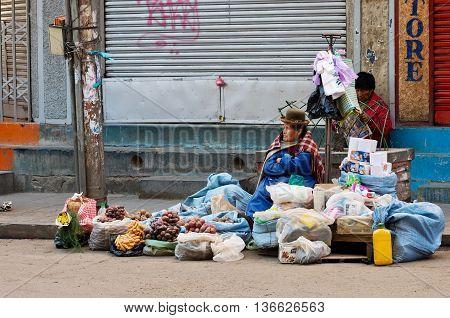 Bolivian Women Sells Vegetables On The Street Market