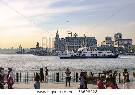 Istanbul Turkey - May 29 2016: Strait of Istanbul Kadikoy Pier Haydarpasa train station and Ferries. Istanbul Haydarpasa Terminal or Haydarpasa Terminus (Turkish: Haydarpasa Garı) is a railway terminal in Istanbul. Until 2012 the station was a major inter