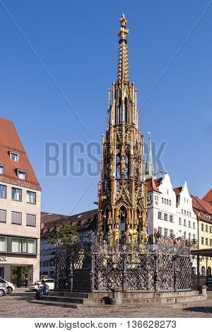 Nurnberg Bavaria / Germany - July 17th 2014: 14 th century Schoner Brunnen fountain in Nurnberg