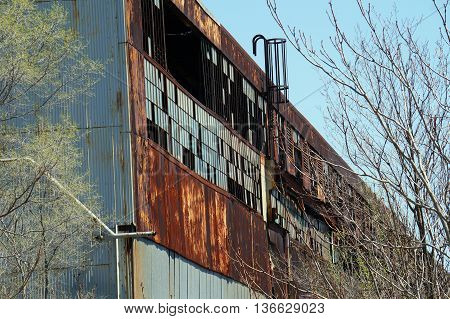 The ruins of the old Joliet Steelworks, its sheet-metal walls rusted and falling apart, in Joliet, Illinois.