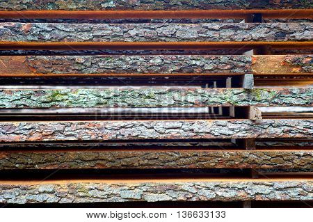 The stack of unedged board. Texture background
