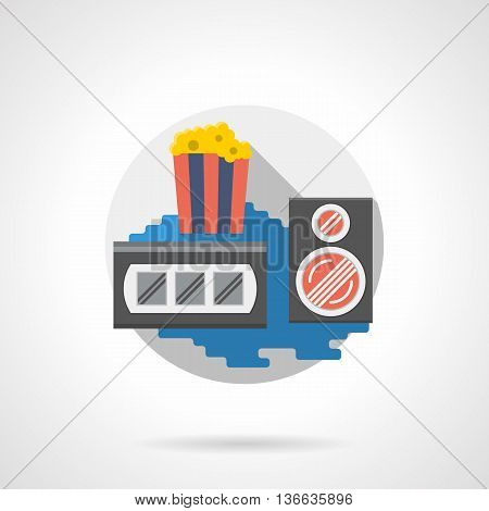 Full disposable striped cup with popcorn, videocassette and audio speaker. Media and entertainment accessories. Cinema and movie theme, retro style. Round detailed flat color style vector icon.