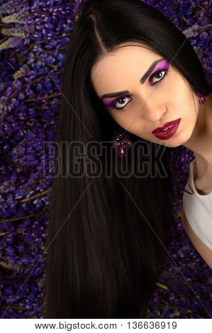charming brunette woman with bright makeup in studio
