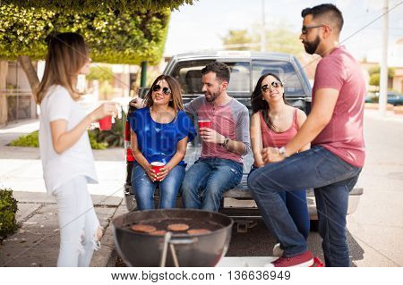 Group Of Friends Talking At A Barbecue
