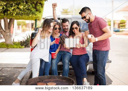 Group Of Friends Watching Baseball Outdoors