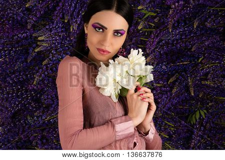 pretty woman with a white peony in hands