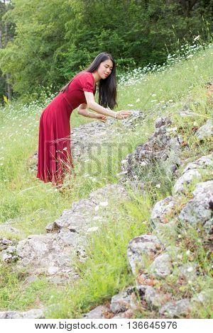 Woman In Flower Picking Wearing Red Dress