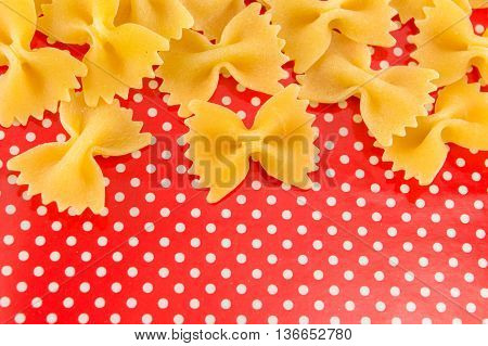 Uncooked Bow Tie Farfalle Pasta On Red Background