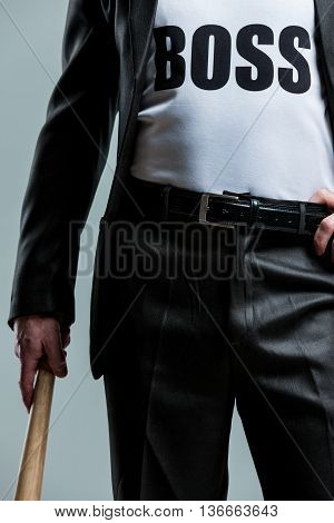 Cropped View Of Man With Bat And Boss On Shirt