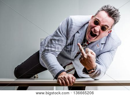 Angry Crazy Businessman Showing Middle Finger