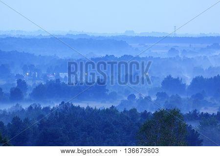 Hazy dusk after rain in Holy Cross Mountains, Poland