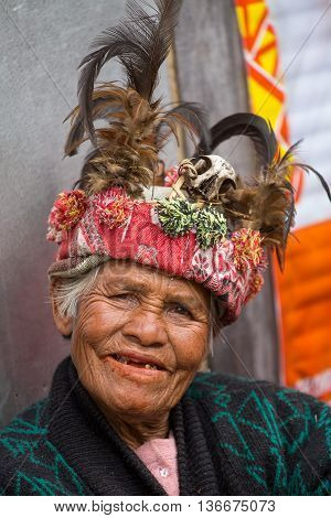 BANAUE PHILIPPINES - JANUARY 24 2014 : Unknown old ifugao woman in national dress next to rice terraces. Ifugao - the people in the Philippines. Refers to the mountain peoples.