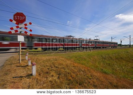 Commuting red passenger train with motion blur