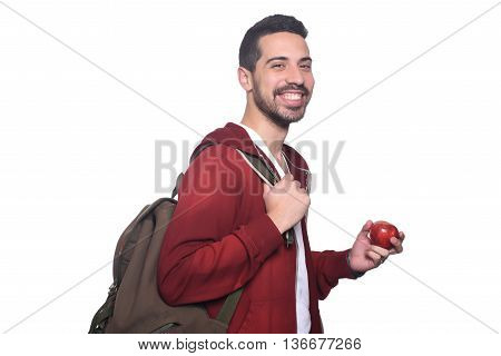Portrait of young latin student with an apple and backpack. Isolated white background.