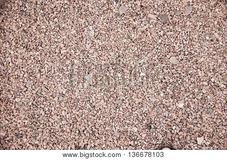 red granite fraction of small pebbles texture background.