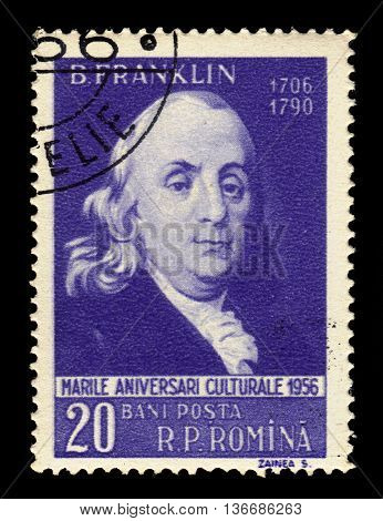 ROMANIA - CIRCA 1956: a stamp printed in the Romania shows Benjamin Franklin (1706-1790) american politican, one of the Founding Fathers of the United States, circa 1956