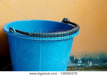 Blue water plastic bucket in the restroom