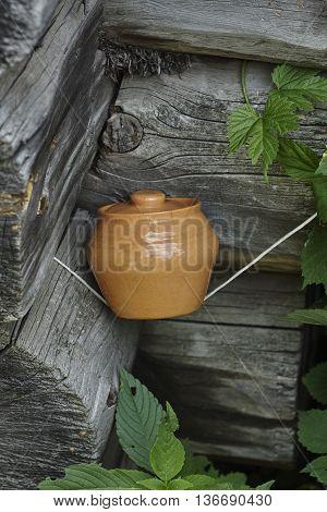 brown vintage pot in blockhouse corner close up